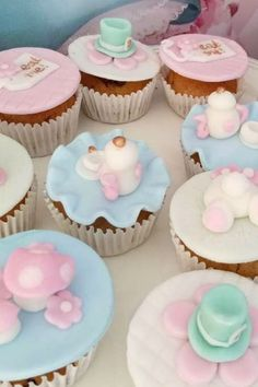 Take a look at this magical Alice in Wonderland baptism! The cupcakes are so pretty! See more party ideas and share yours at CatchMyParty.com    #catchmyparty #partyideas #aliceinwonderland #cupcakes #aliceinwonderlandparty #baptism #teaparty