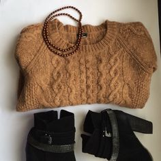 JCrew cable knit sweater 3/4 sleeves, the tag with the size has been cut but I think it was a Large. Supposed to fit a bit cropped but I wear a small and this sweater fit as mid length small. Very soft and warm, light brown J. Crew Sweaters Crew & Scoop Necks