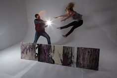 siblings fooling around, during ART photo shoot  mr tilley & mj the next level art collective purple art tables