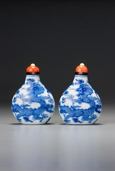 Two blue and white porcelain 'dragon' snuff bottles Imperial kilns, Jingdezhen, Daoguang four-character marks and of the period, 1821–1850