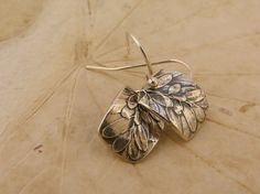 Gina Solomko - Silver earrings, leaf design on ball ear wires by Synchronicity Design. $58.00, via Etsy.