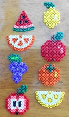 Set of 8 different fruits created with Hama beads. Sizes of fruit vary. Apple measures 2 x 1 Great to hang on your windows! Available as a hanger or magnet. Hama Beads Design, Diy Perler Beads, Perler Bead Art, Pearler Beads, Hama Beads Kawaii, Hama Beads Coasters, Perler Bead Designs, Melty Bead Patterns, Pearler Bead Patterns