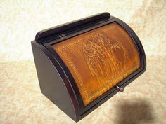 Mr. Ginter:  I received the black over red with wheat tin punched cover bread box on Friday – exactly as your email said it would be delivered.  IT IS GORGEOUS!!!!  It's bigger than I thought it would be, the paint is gorgeous (red matches our kitchen perfectly), and the wheat punched front is rustic and perfect!  Thank you for your timeliness and thoroughness with my order.   Thank you again and we will enjoy the breadbox for many years to come.  Sincerely,  Mary Wolfe