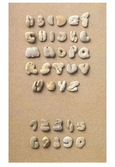 alphabet and number shaped rocks