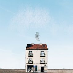 In Lonely Houses, Sejkko photographs Portugal homes standing alone amidst a background of blue skies and rolling landscapes. Cabana, Portugal, Watercolor Architecture, Minimalist Photography, Light Painting, Traditional House, Lonely, Exterior, Instagram