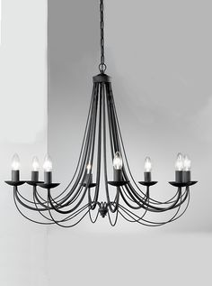 FL2173/12 Philly Italian ironwork 12 light pendant, satin black. Italian ironwork fitting in satin black finish. Optional candle-clip shades available (sold seperatly) where shade is use maximum wattage reduces to 40W. 12 x 60w E14 Candle Lamps not included Height- 216cm Minimum Height- 74cm Diameter- 108cm Weight-14Kg BRAND- Franklite REFERENCE- FL2173/12 AVAILABILITY: 3-4 Working Days