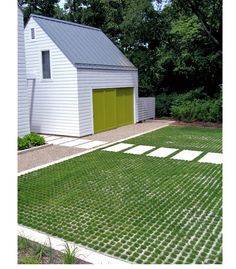 """The soil level well below the level of concrete so the crown of each individual grass plant is protected. """"Even if a car is parked right on top, the tire is supported by the paver, and the crown of the grass plant is below,"""" says Kettelkamp.  Illinois-based landscape architects Kettelkamp & Kettelkamp."""
