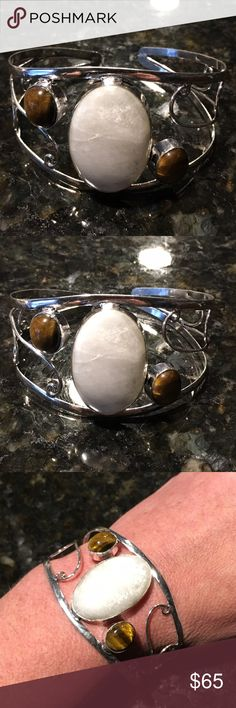 925 SS cuff bracelet with moonstone & tiger eye Handmade Absolutely stunning 925 Sterling silver cuff bracelet with large moonstone and Tiger eye genuine stone!  Brand-new and never been worn! Adjustable for size! GRV Jewels Jewelry Bracelets