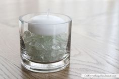 DIY Candle Votive.  Perfect for filling up your table centerpiece decor or around your home.  Fill a clear glass vase with crushed glass vase filler in the color of your choice and top with a candle.  Fill with water or leave as is!