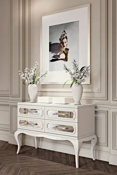 This exquisite chest of drawers is made from solid wood and finished in a white lacquer. Featuring 4 antiqued mirrored panelled glass drawers, seductively curvaceous legs and feature crystal handles. Discover the High End Modern Mirrored Chest of Drawers at Juliettes Interiors, the most striking addition to any setting. A statement piece for any room in the house, providing the most beautiful of storage solutions.