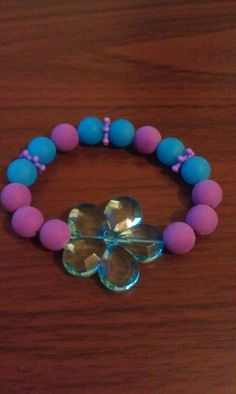 Girls stretch bracelet purple & blue with blue flower center. Girls jewelry