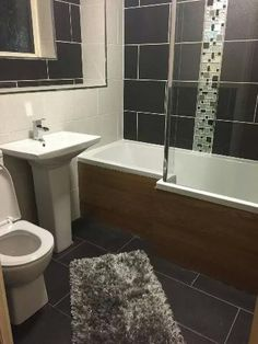 #VPShareYourStyle sean from hull uses a grey rug, black tiles and white bathroom furniture to create a monochrome theme.
