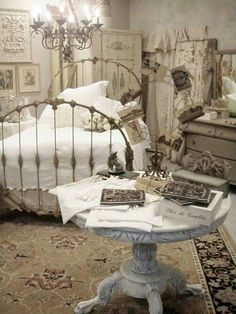 """Great romantic Shabby Chic Victorian setting with an antique """"wedding band"""" iron bed."""