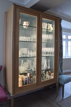 Glass Display Cabinet Exceptional Design for a Living Kitchen & Excellant use of LED low voltage strip lighting inside this custom ...