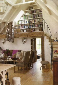 Rustic library loft. (Elle Decor) ...high ceilings, yet cozy....great use of natural light and textures