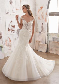 Gorgeous Fit & Flare Wedding Dress Featuring Embellished Bodice Adorned with Venice Lace AppliquŽés on Net. An Off-the-Shoulder Illusion Neckline and Cap Sleeves. Matching Satin Lining