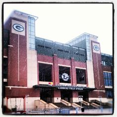 Lambeau Field, in the rain, home of the Green Bay #Packers and all its citizens. 7/17/12 I was watching construction work being done on new seating. Does this ensure a seat for everyone in town now? Nice looking stadium, inside and out.  lol  #football #nfl