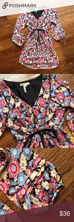 "BCBG Floral Dress Colorful lightweight dress with a high low slimmed frame. Filling lined with  fun detailing on the ends of the sleeves (see pic 3)  • Measures 33 1/2"" long in the back and 29 1/2"" long in front (measured flat from high shoulder point to hem)  • 100% polyester  • No Trading  • Reasonable Offers are Always Welcomed BCBGeneration Dresses"
