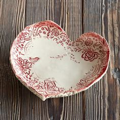 "HEART DISH -- Handmade by Rebecca Puig in USA, this sweet dish will delight your heart. Clay-fired porcelain with lead-free matte glaze. 8-3/4"" dia."