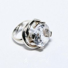 Jewelry designer Maria Hamilton beautiful sterling silver Clarisa ring holds an elevated 35ct clear quartz, surrounded by 7 set in diamonds. Available in full and half sizes for your convenience. A go