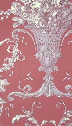 Biltmore Wallpaper An elegant toile wallpaper with urns and cherubs cream outlined in dark red with a coral red background.