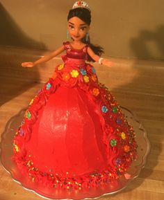 Simple Elena of Avalor doll cake. I used a Wilton wonder mold pan with an additional 9 inch round underneath and store bought red Pillsbury Radiant Red Vanilla funfetti icing and Wilton flowers from Walmart's cake decorating craft isle. Threw this together pretty quickly, try it!!!