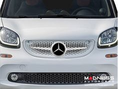 Mercedes makes the Smart Car... so why not pimp one out with this customized Mercedes grill ?