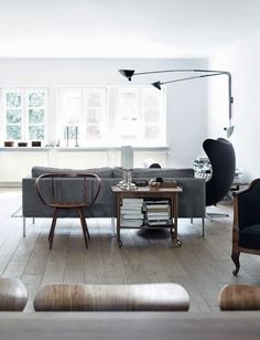 """Wolfram, Christian and their 2 kids, Leah and Aaron live in this former warehouse in the waterfront area of Hamburg. Wolfram filled the family home with wood to add warmth to an otherwise color-free space : """" I like non-colours, says Wolfram, I find them calming and I they are the DNA of my style""""...."""