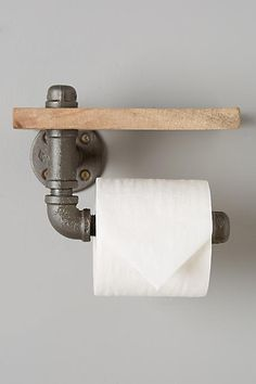 Industrial toilet paper holder and small shelf from Anthropologie.  Arc and Timber Pipework.