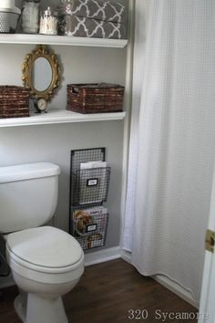 bathrooms - Glidden - Fossil Grey - Target White Waffle-Weave Fabric Shower Curtain gray walls Home Depot white floating shelves glass canisters HomeGoods gray white Moorish tiles towels T.J. Maxx wire wall magazine racks Michael's baskets