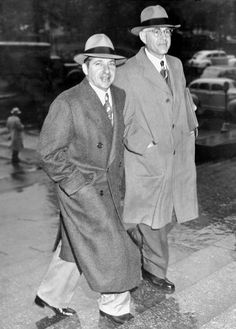 Frank Costello (l.) with his attorney, George Wolf, heads to another courtroom appearance in 1943.--Five Families of New York City: Mob Style: Gangsters Throughout The Years