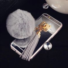 Iphone 6/6s Fur ball with Tassel Phone case Brand new. No scratches. Cover is made of jelly plastic. Protects the phone case and looks very cute! ✨ Accessories Phone Cases https://www.etsy.com/shop/ElectricTurtles