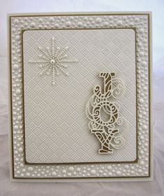 Hi bloggers! While this sample card certainly isn't the most flashy, it is very striking in real life. I started with a piece of Rich Green card and embossed it with the new Nordic Trees folder to
