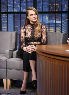 Time for a chat: Cara looked comfortable and relaxed as she chatted to host Seth Meyers...