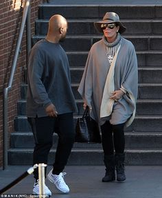 Covered up: Kris Jenner wore a floppy hat, sunglasses and grey wrap while having lunch with boyfriend Corey Gamble at the mall in Century City,  Los Angeles on Sunday