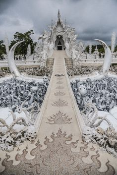 this white temple in thailand is both heaven and hell is part of White temple - This White Temple In Thailand Is Both Heaven And Hell Beautifulart BoredPanda Places Around The World, Travel Around The World, Around The Worlds, Chiang Rai, Beautiful Places To Travel, Beautiful World, White Temple Thailand, Heaven And Hell, Parc National