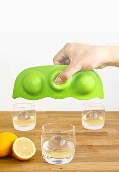 This pea pod ice mold makes gorgeous ice globes that keep cocktails cold and classy.
