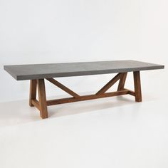 Reclaimed Teak wood makes a bold statement with our raw concrete table top. Both materials perfectly suited for the outdoors. Available in multiple sizes t