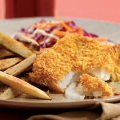 Oven frying is the secret to this amazing healthy makeover of fish and chips...just 325 calories, 5 grams of fat and 0 grams of sat fat! #eatingwell