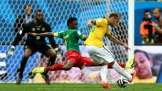 BRASILIA, BRAZIL - JUNE 23: Neymar of Brazil scores his team's second goal during the 2014 FIFA World Cup Brazil Group A match between Cameroon and Brazil at Estadio Nacional on June 23, 2014 in Brasilia, Brazil. (Photo by Clive Mason - FIFA/FIFA via Getty Images)  2014 FIFA World Cup Brazil™: Cameroon-Brazil - Photos - FIFA.com