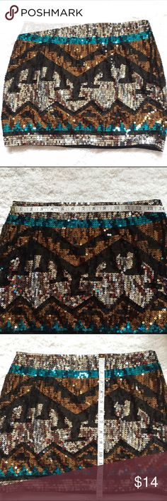 NWOT Aztec sequined mini skirt geometric Sz L Stunning sequined skirt with Aztec pattern. Size large Brand Envy Me See photos for measurements envy me Skirts Mini