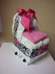 Black and white Damask with Hot Pink diaper bassinet, baby shower decoration. $13.00, via Etsy.