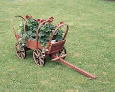 Amish Traditional Covered Wooden Wagon This lovely outdoor planter even comes with a cover if you'd like! Unique planter to enhance outdoor displays. Great for flowers, herbs and more! #planters #outdoordecor