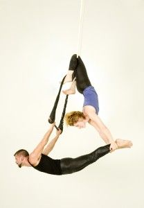 knee hang in ropes to base small amts of weight from. photo from workshop at aerialsilksatlanta.com