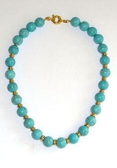 Turquoise necklace with vintage gold elements