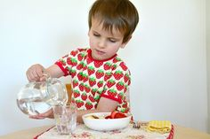 Table manners are very important in our home. They are important at school too. Grace and Courtesy are a big part of the Montessori curriculum. It is one of many areas that make Montessori classrooms special. Often in Montessori classrooms, from toddlerhood, children will sit at a table to eat...