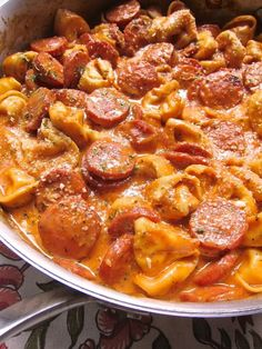 Cheesy Smoked Sausage Skillet - smoked sausage, tomato sauce, chicken broth, heavy cream, refrigerated cheese tortellini and parmesan. Everything cooks in the same pan! Even the pasta!! SO easy and super delicious! We ate this 2 nights in a row. #chickenfoodrecipes