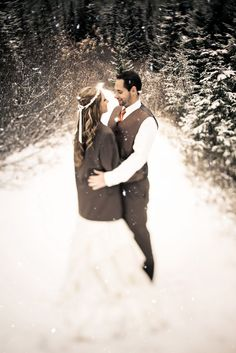 Sweet picture of the bride in her husband's jacket. Winter wedding inspiration!   Clane Gessel Photography