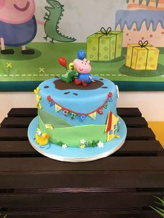 What a fun cake at a George & Dinosaur birthday party! See more party planning ideas at CatchMyParty.com!