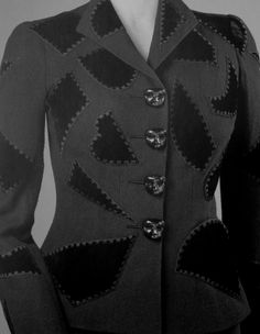 Schiaparelli Jacket with face buttons, 1930s?